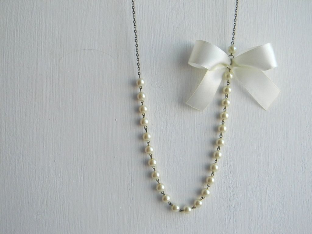 Ivory pearl necklace with bow. $24.00, via Etsy.