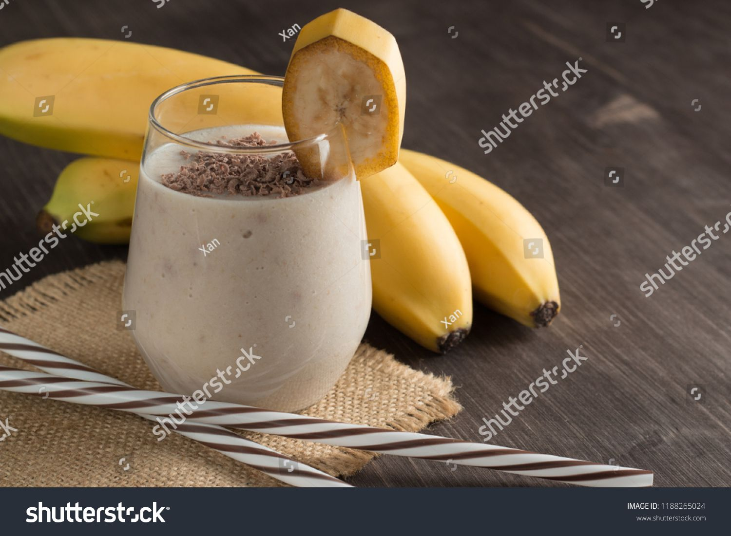 Photo of fresh Made Chocolate Banana Smoothie on a wooden table with cookies, banana and coconut. Milkshake. Protein diet. Healthy food concept. Drink, coffee beans, chocolate. #Sponsored , #AD, #table#wooden#cookies#coconut #chocolatebananasmoothie