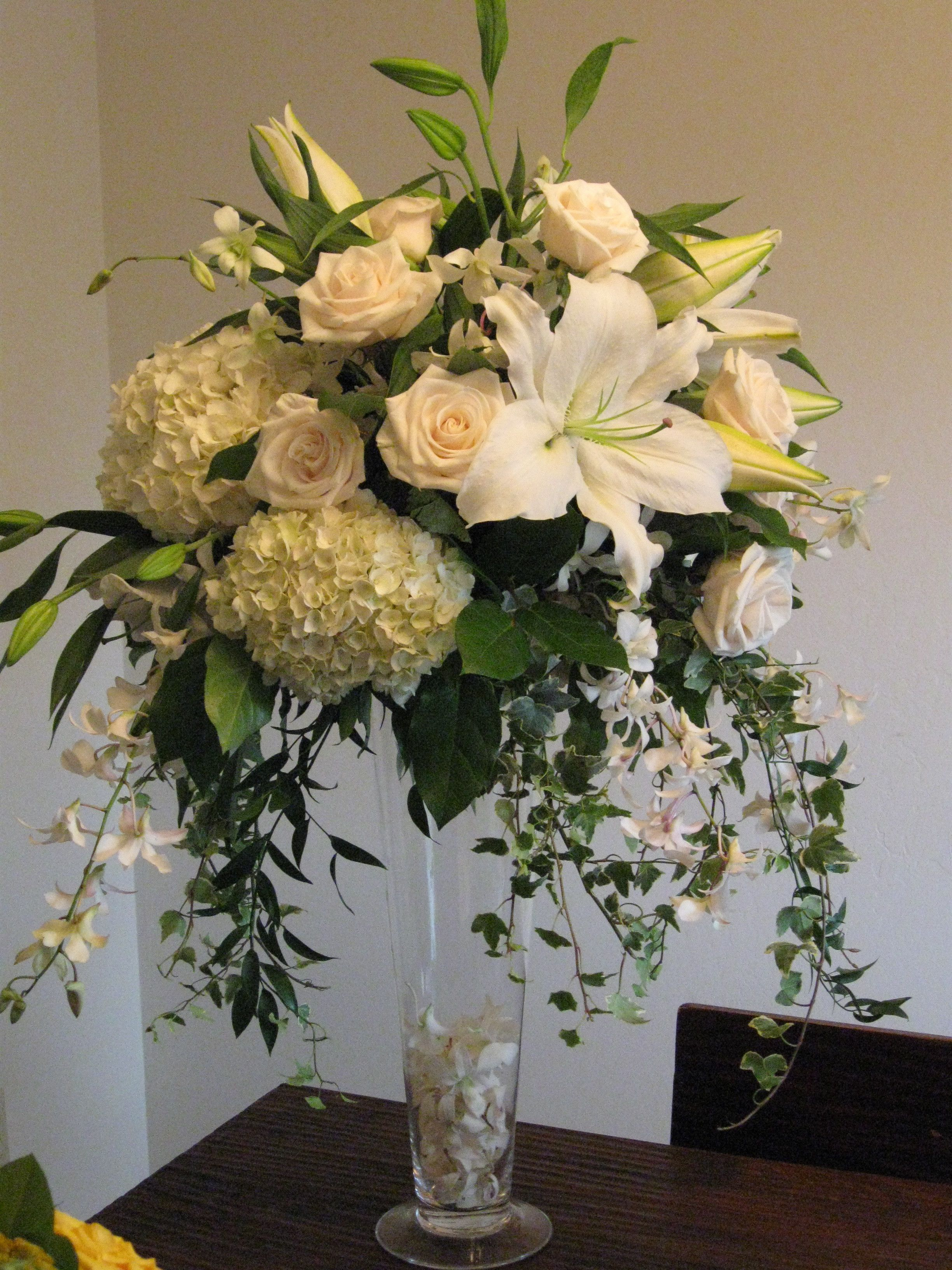 Centerpiece white roses hydrangea orchids tall
