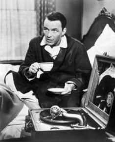 Frank Sinatra with cup of , probably, coffee.
