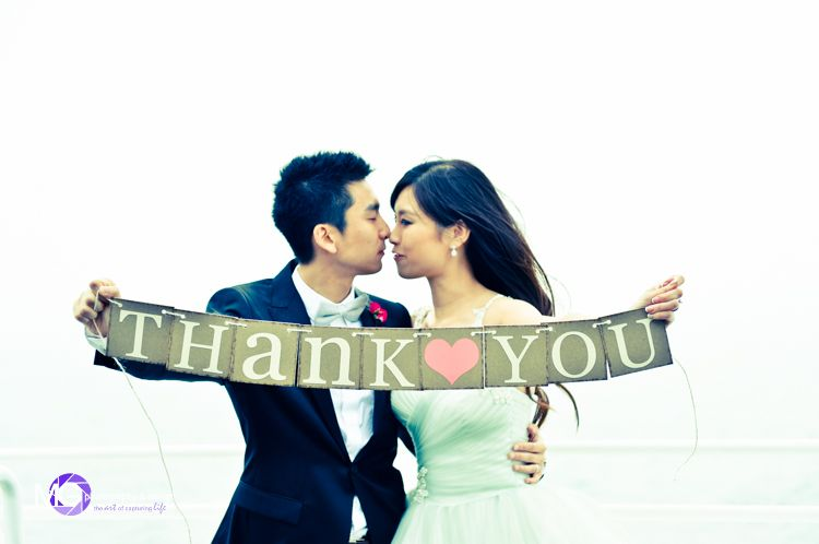 A photo taken the day of your wedding for thank you cards is a great way to show your guests you were already thinking of them.   Photo: MG-Photography.com