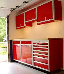 Garage Cabinets Can Organize A Messy Garage Whether You Use New Or Recycled Cabinets Find Out What S Available Garage Door Makeover Metal Garage Doors Garage