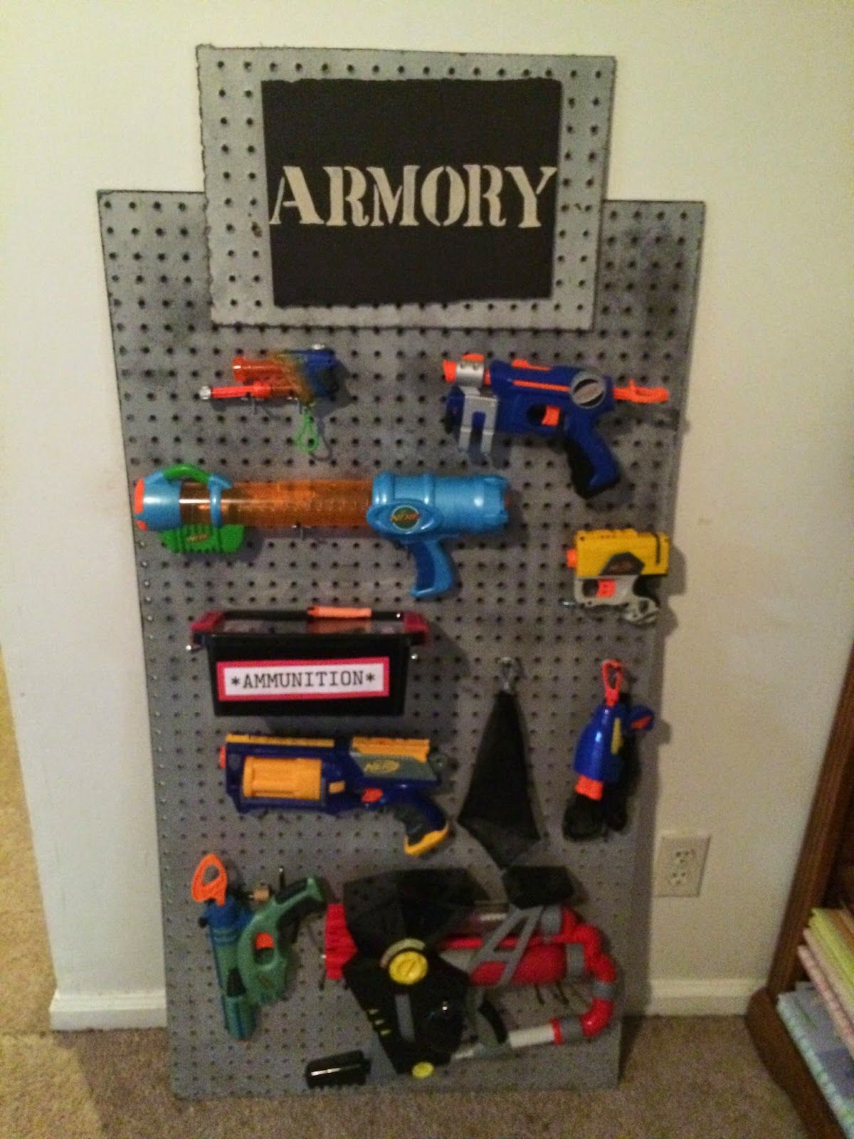 spy party armory on pegboard also good for a toy room place to