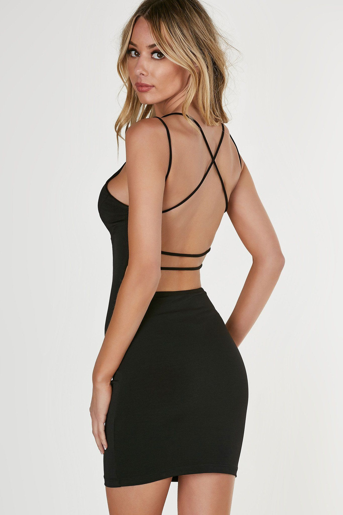 V-neck sleeveless dress with strappy detailing and open back. Form ...