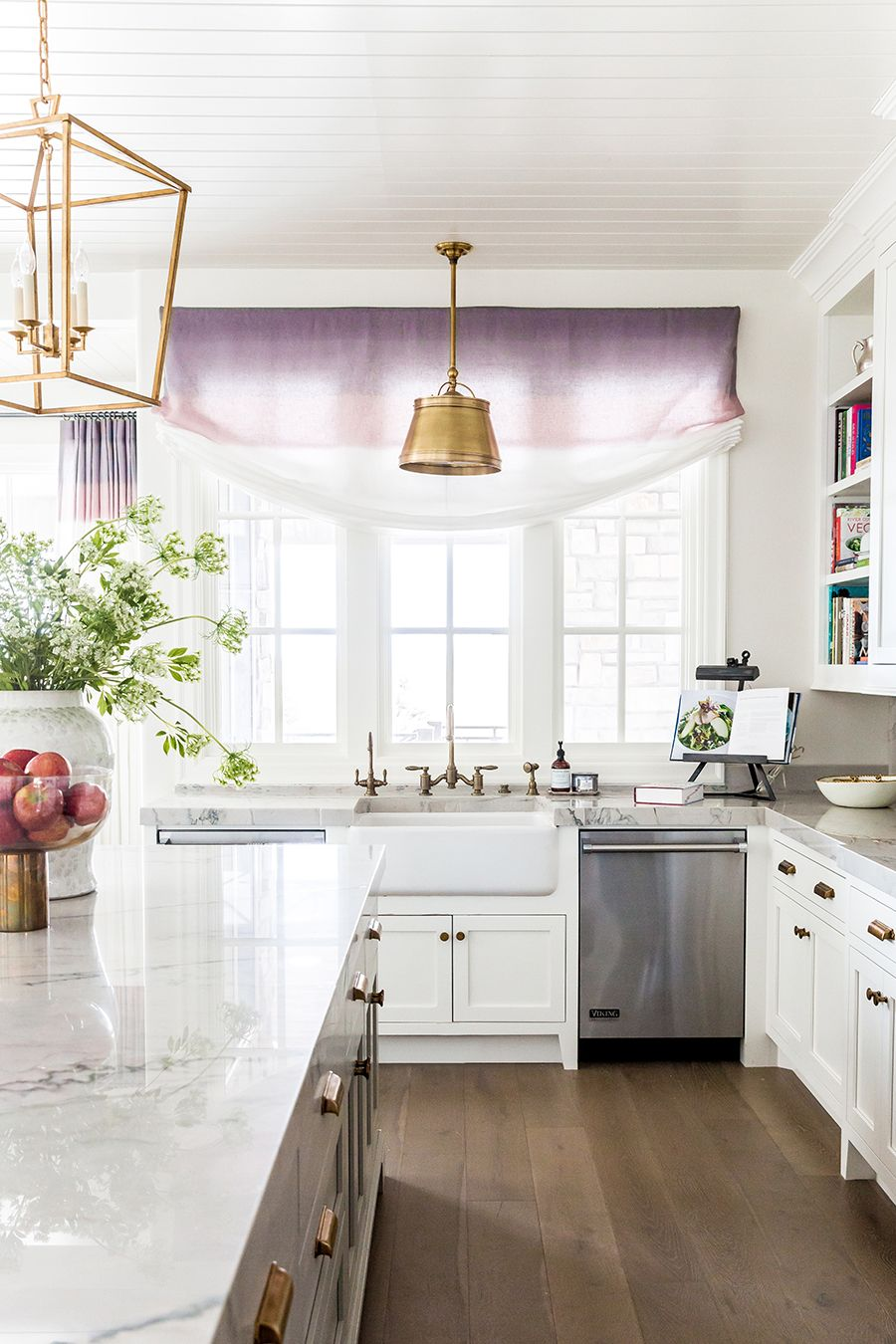 Gourmet kitchen features a farmhouse sink fitted