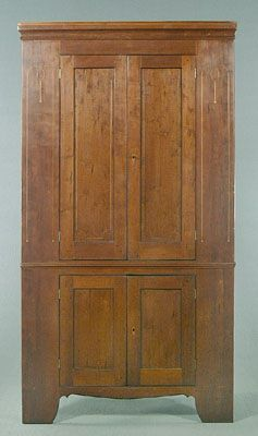 """Inlaid 19th century cherry corner cupboard, two frame-and-panel doors with canted corner string inlay flanked by wide panels with curved string and dot inlay, two frame-and-panel doors below, wide vertical backboards with cut nails (lacking original nails), secondary wood poplar, probably Georgia 85 x 45 x 20"""""""