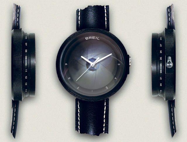 2108fc156296 Paparazzo es un reloj con forma de lente de una cámara