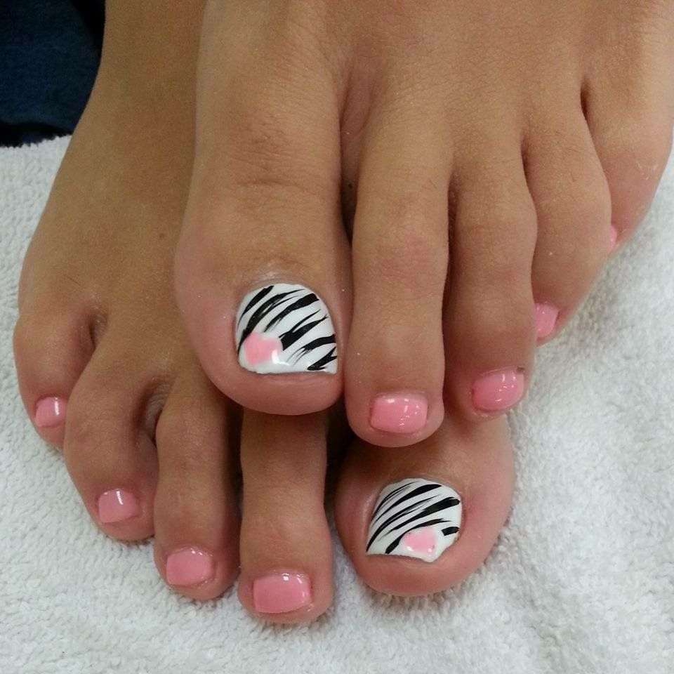 Pink nails with a white and black zebra print accent nail with a ...