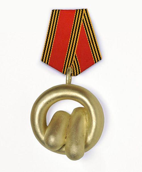 Peter Bauhuis  Medal: Asparagus Order of Doberlug 2012  Zinc silver, textile