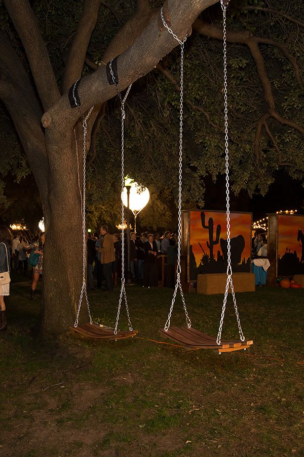 Wine barrel swings hanging from the trees.