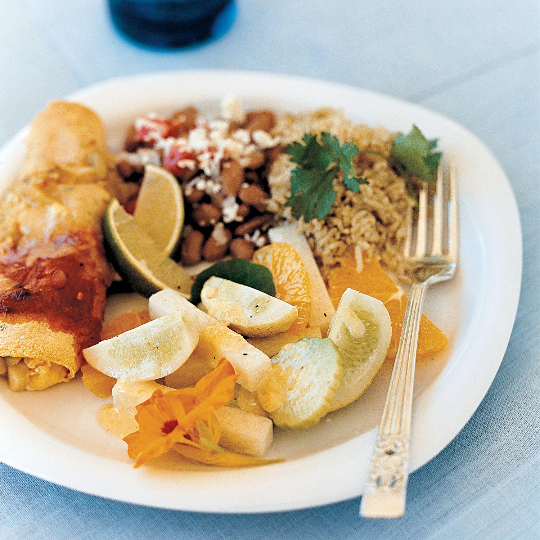Breakfast Enchiladas - The enchilada filling includes summer squash, mushrooms, eggs, and cheese.