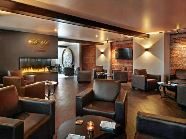 A Modern Gas Fireplace Divides The Davidoff Lounge In Ridgewood Into Two Conversation Areas