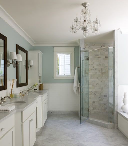 bathrooms soothing blue walls chair rail subway tiles backsplash corner frameless glass shower calcutta marble - Bathroom Subway Tile Backsplash