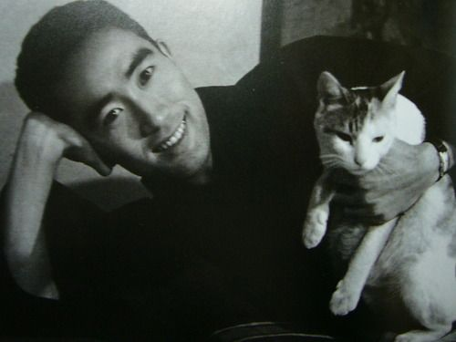 Image result for Japanese writer Yukio Mishima and his personal library (and cat).