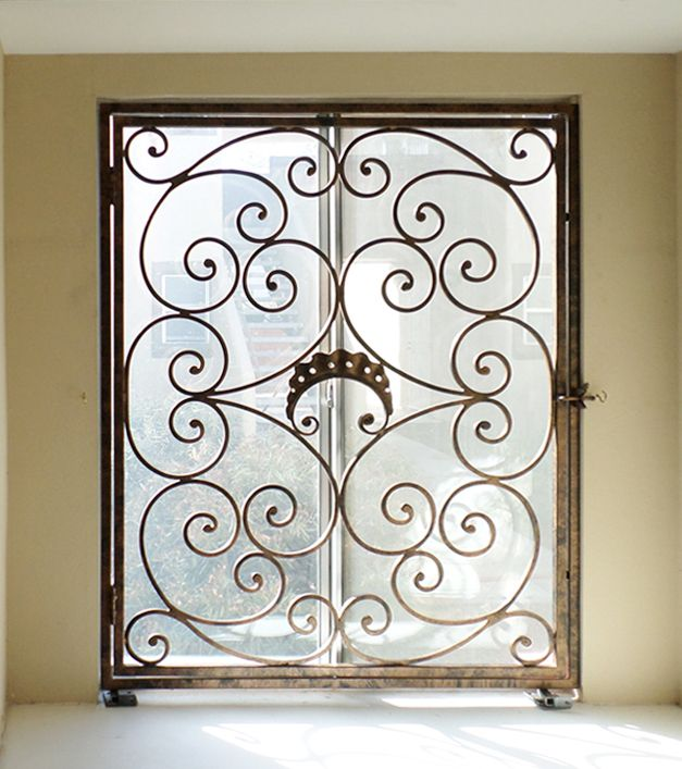 Wrought iron window guard would look pretty on house with for Window protector designs