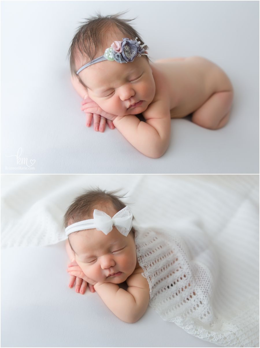 Sleeping newborn baby girl on white backdrop