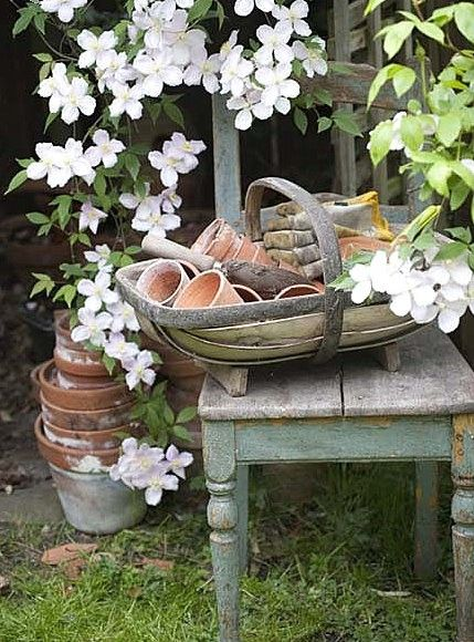 FleaingFrance.com - old terra cotta pots, a lovely English trug, and a weathered old potting table