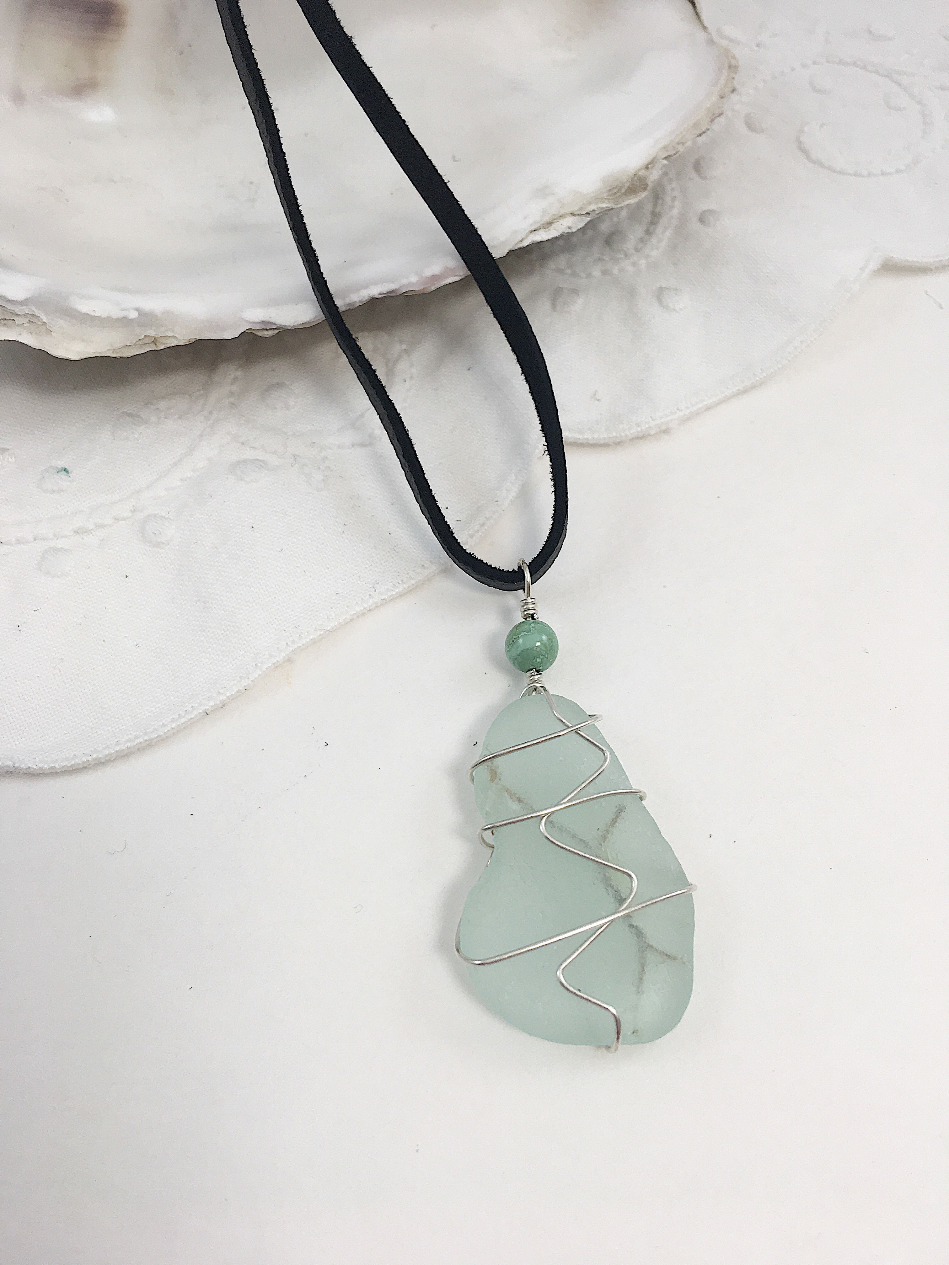 Light aqua sea glass - safety glass - that is wire wrapped with ...