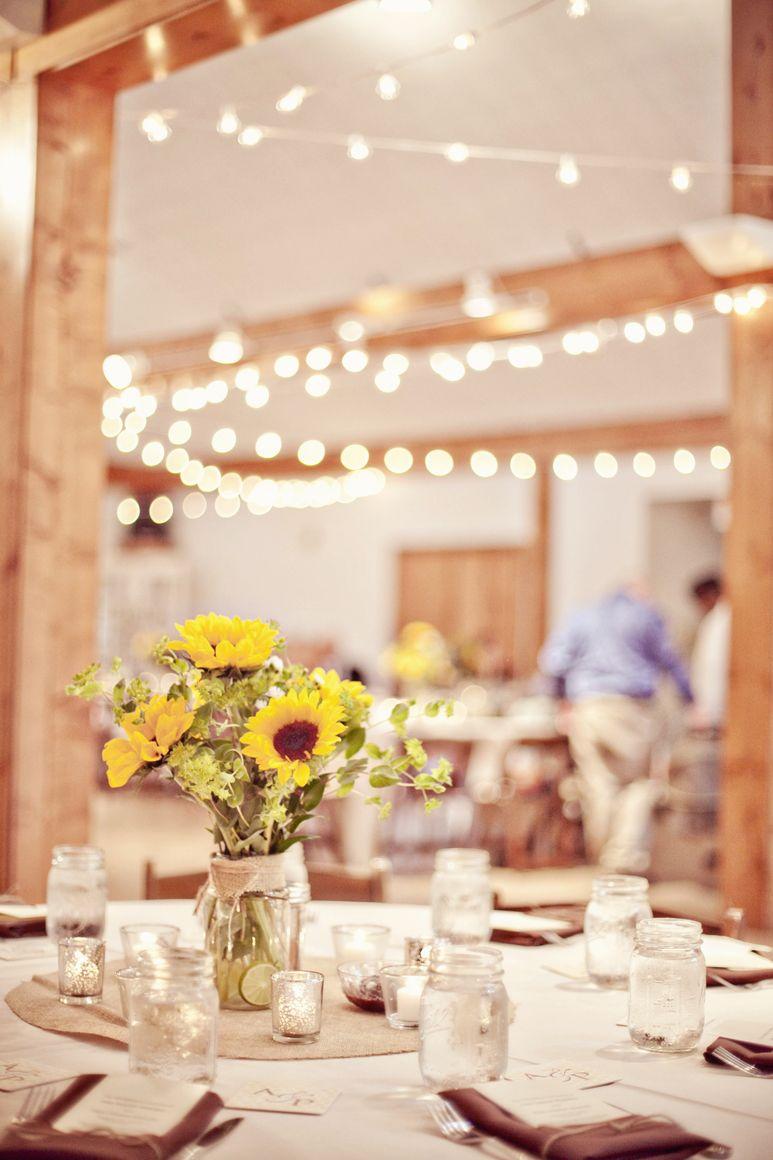 our wedding table setting. #wedding #sunflowers #masonjars ...