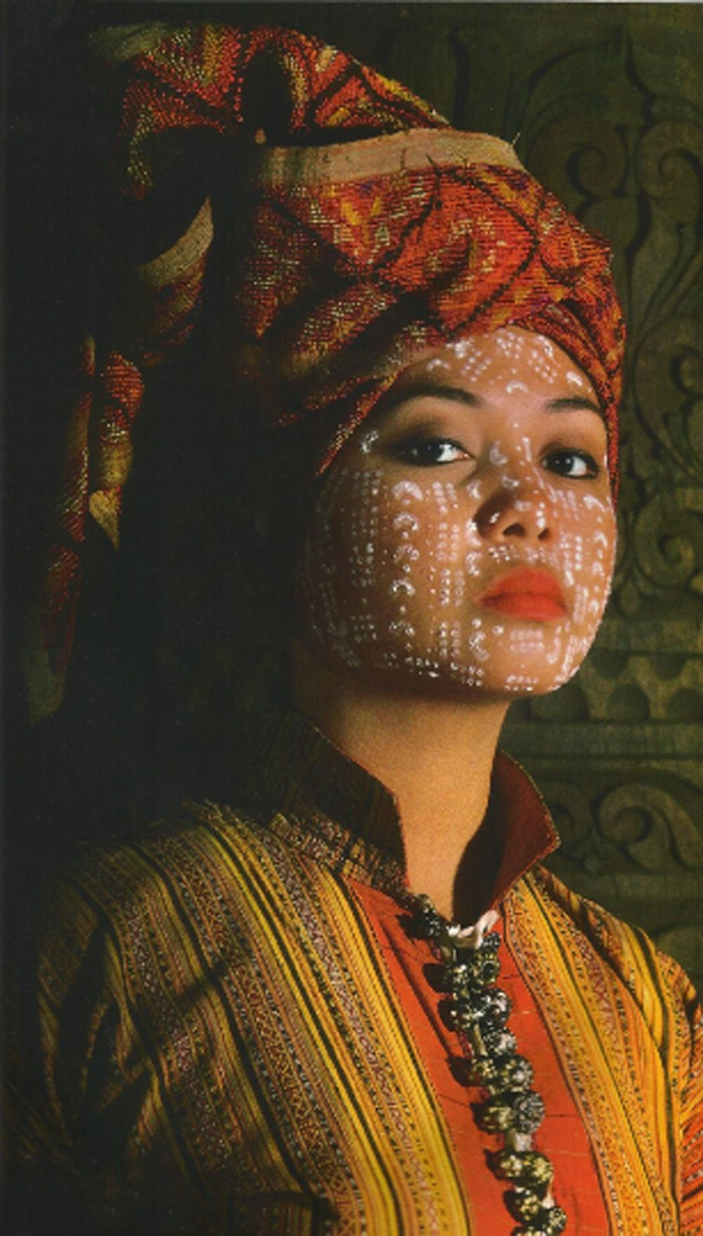 Asia | Yakan woman with traditional painted face, Mindanao, Philippines | National Geographic archives.