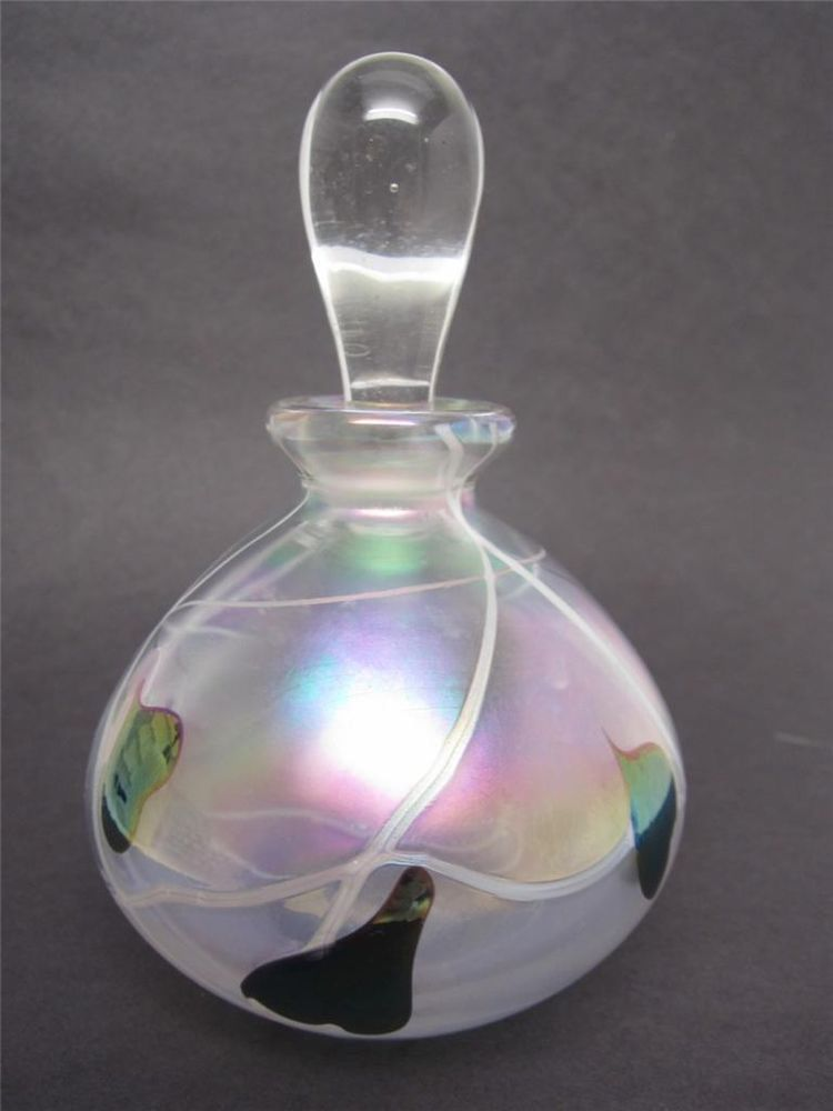 Vintage Glass Art Perfume Bottle gleams