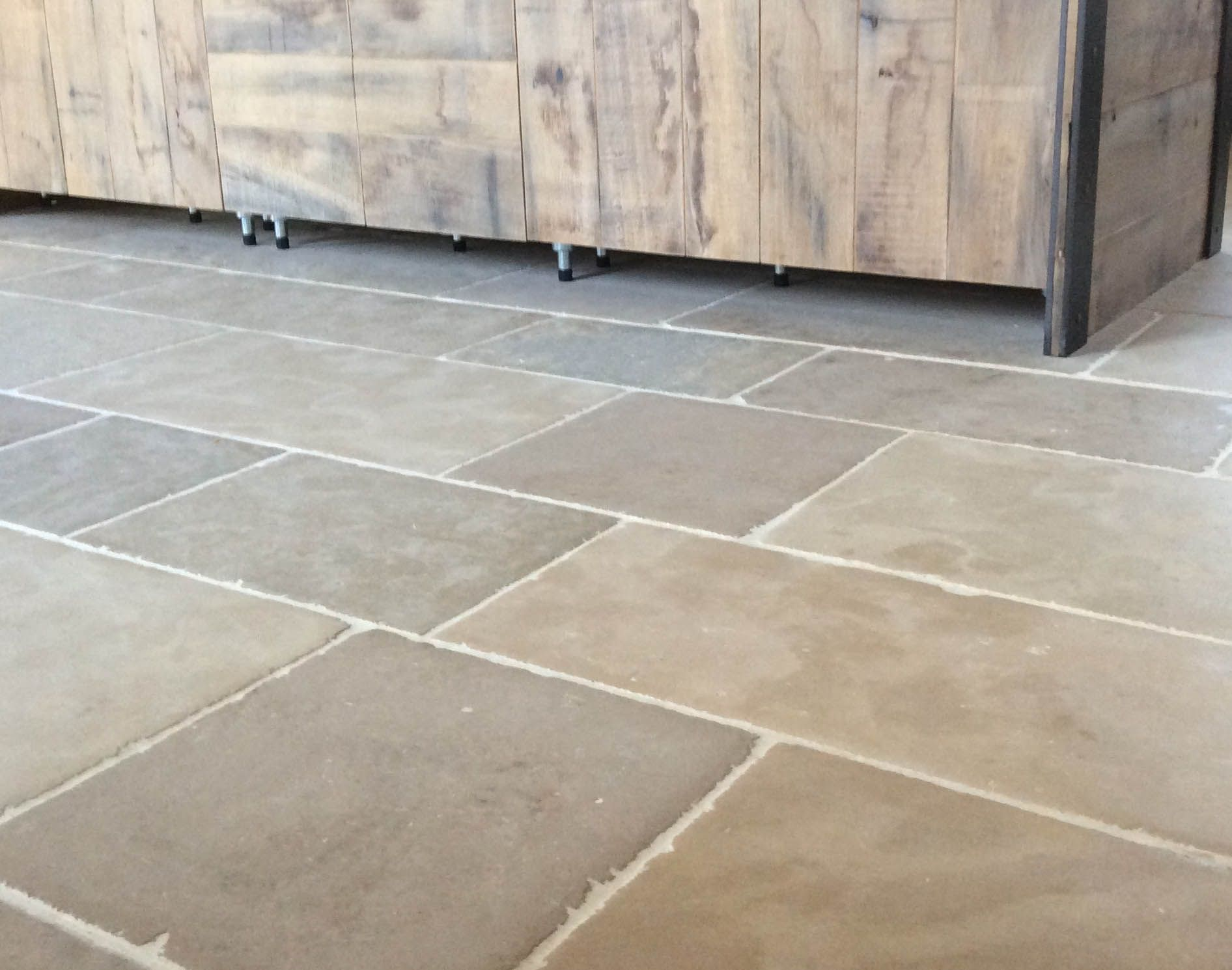 Rustic Kitchen Floor Tiles Made From Montpellier Antiqued Limestone Using Traditional Hand Tools Creates Authentic Time