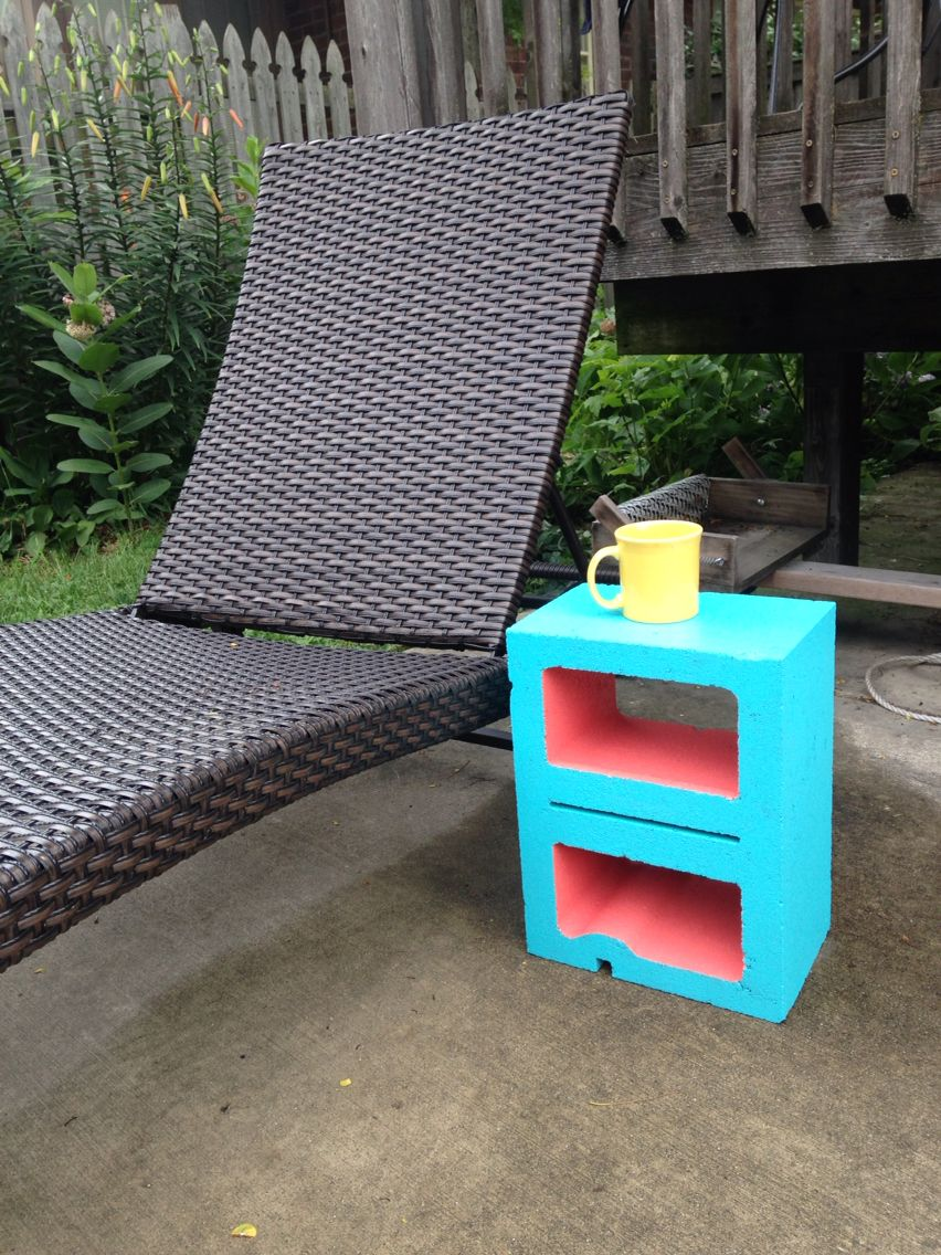 Two-tone cement block table. At a cost of 1.50 for the block and a little leftover spray paint, this is the most economical end table I've seen!