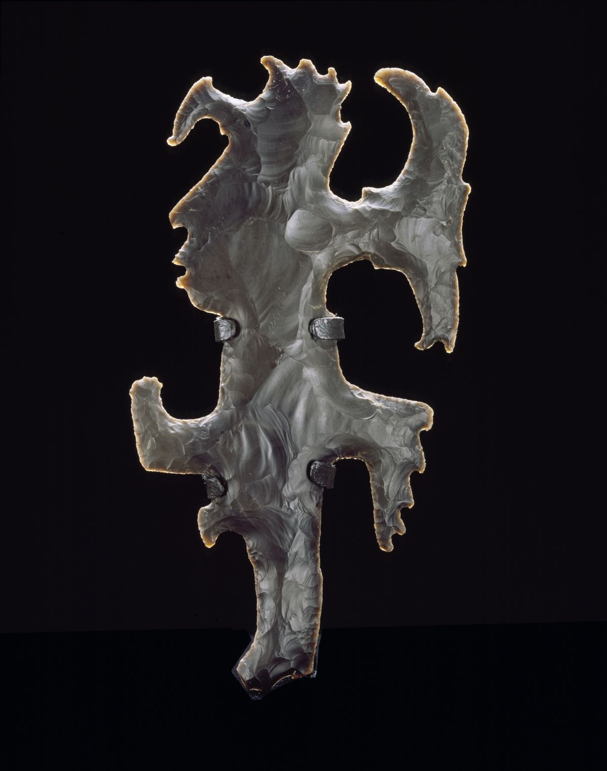 """Eccentric Flint resize - The Pre-Columbian Maya were excellent craftsmen, capable of producing exquisite pieces like this eccentric piece of chert / flint. Some obsidian and chert tools were used as knives, spear points, etc.; this object had no direct utilitarian purpose. Archaeologists and anthropologists like to classify items like these as """"ceremonial,"""" meaning they had a purpose we can only guess at. Perhaps it was used as a symbol of political power, hence the term scepter."""