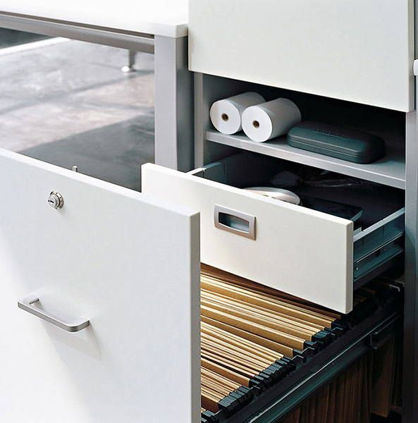 http://spacio.es/mobiliariodeoficina/archivosoficinas/cajoneras-de-melamina/  Cajonera melamina con cajón hueco y archivador para carpetas.