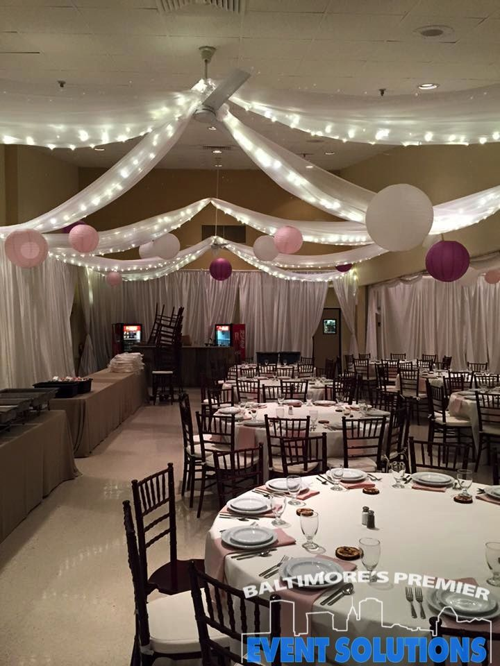 Ceiling Drape, Pipe and Drape and Paper Lanterns for wedding reception at  American Legion in