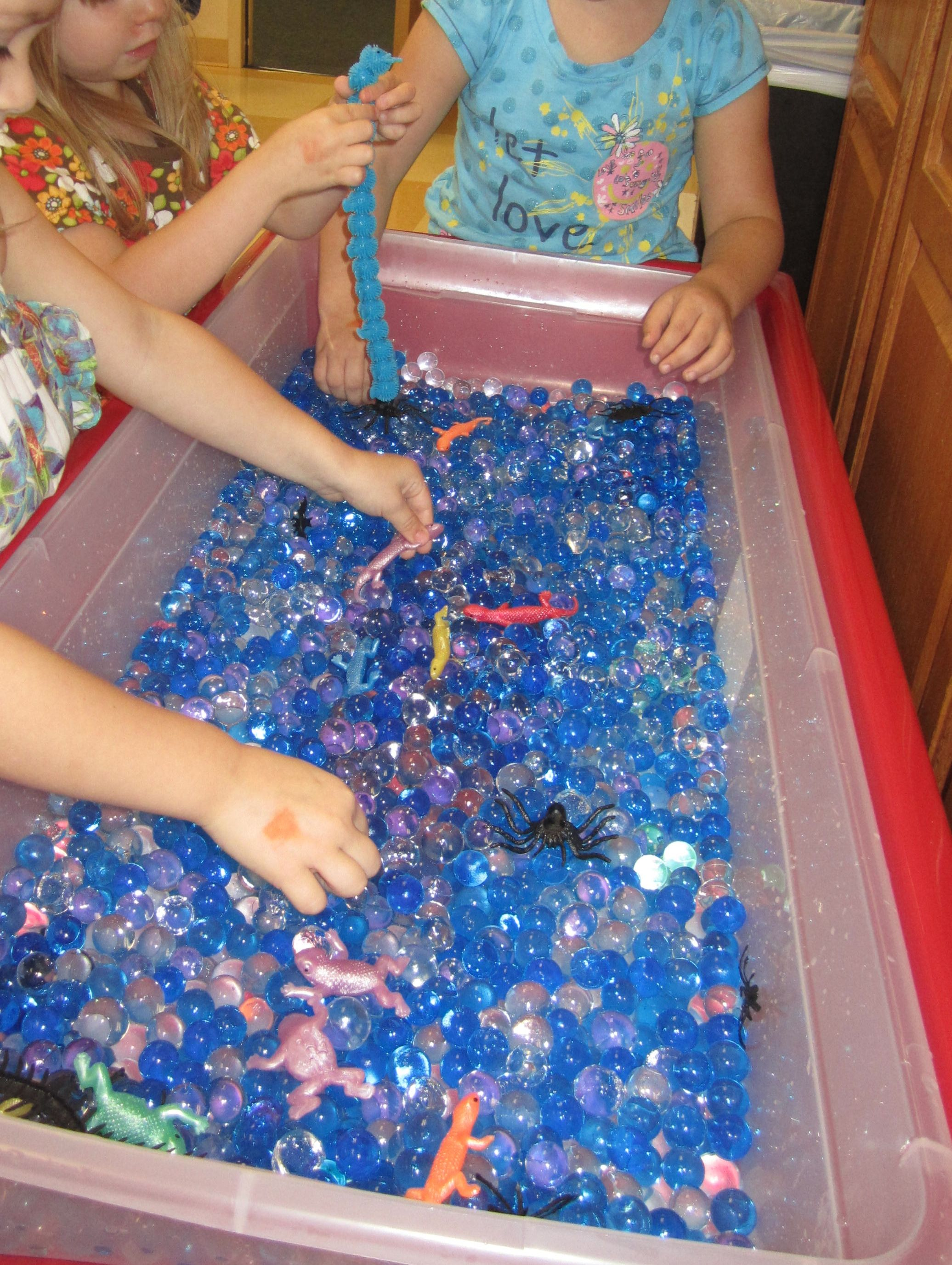 Water beads #October #sensory_table, Put in spiders and rubbers squishy lizards or frogs from dollar store.
