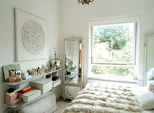 Love this room -- particularly the art and the Moroccan wedding blanket. Also, the window looks like a painting.
