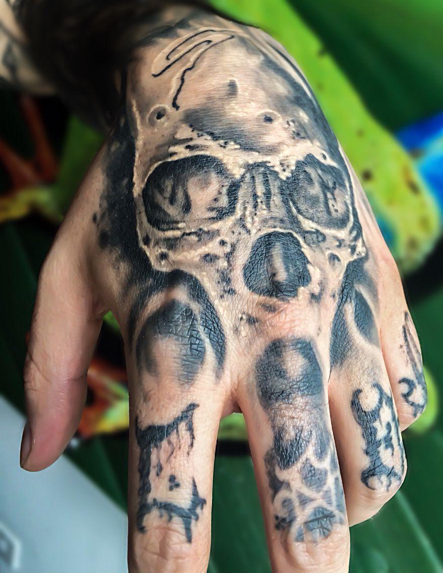 Skull hand tatt healed.  Instagram: @iversontattoo