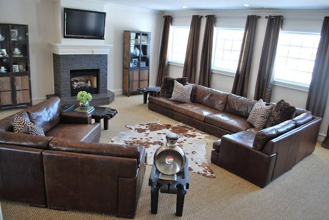 Family room/living room Dk brown leather sofa Large jute area rug ...