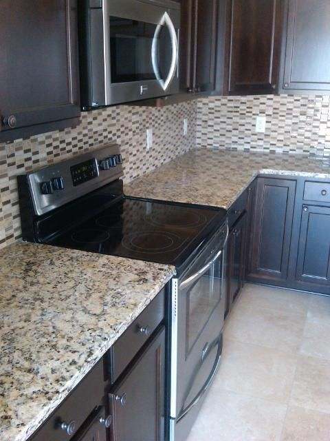 Charming Backsplash Ideas For Busy Granite Part - 13: Espresso Cabinets And Venetian Gold Granite Counter Tops- Love The Counter  Tops And The Cabinets, But NOT The Backsplash! Too Busy For My Taste.