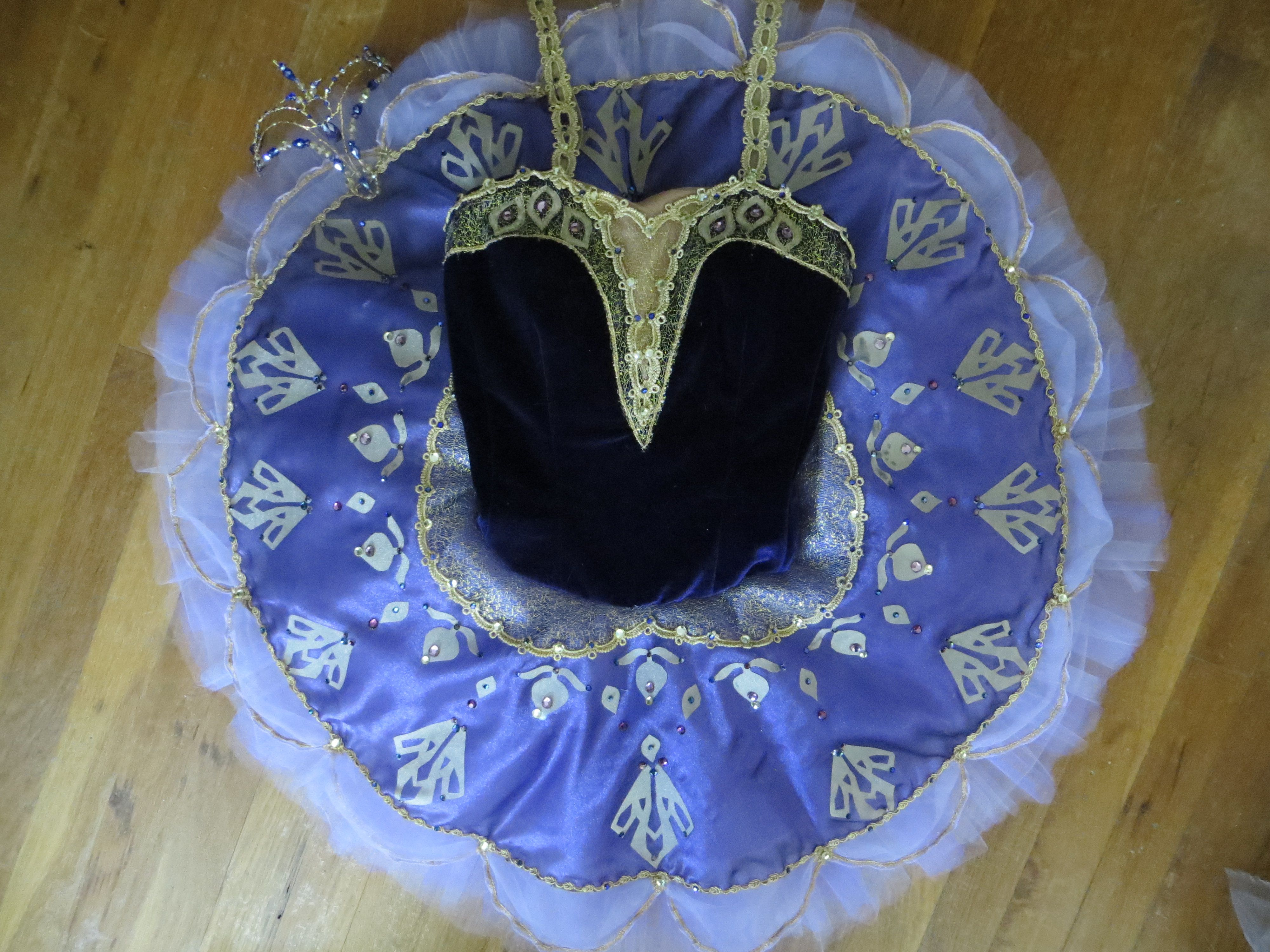 This is a pharaohs daughter tutu that we created after researching Egyptian symbols for YAGP 2014. The head piece in the upper left corner will be the next pin. Enjoy! www.tutuetoile.com