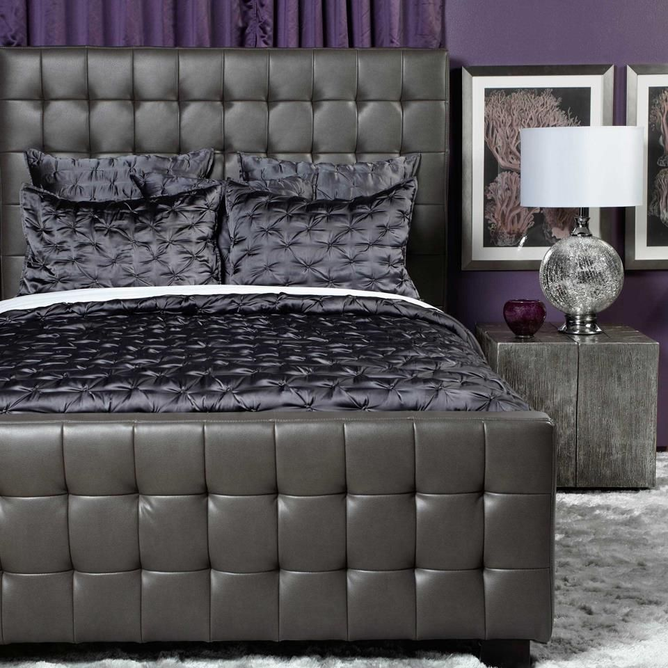 Elegance with purple walls and slate tuffed bed frame from