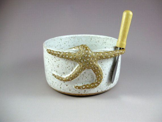 This fun little bowl is great for cheeses or dips and a whimsical hand built starfish holds the spreader. It is wheel thrown in speckled