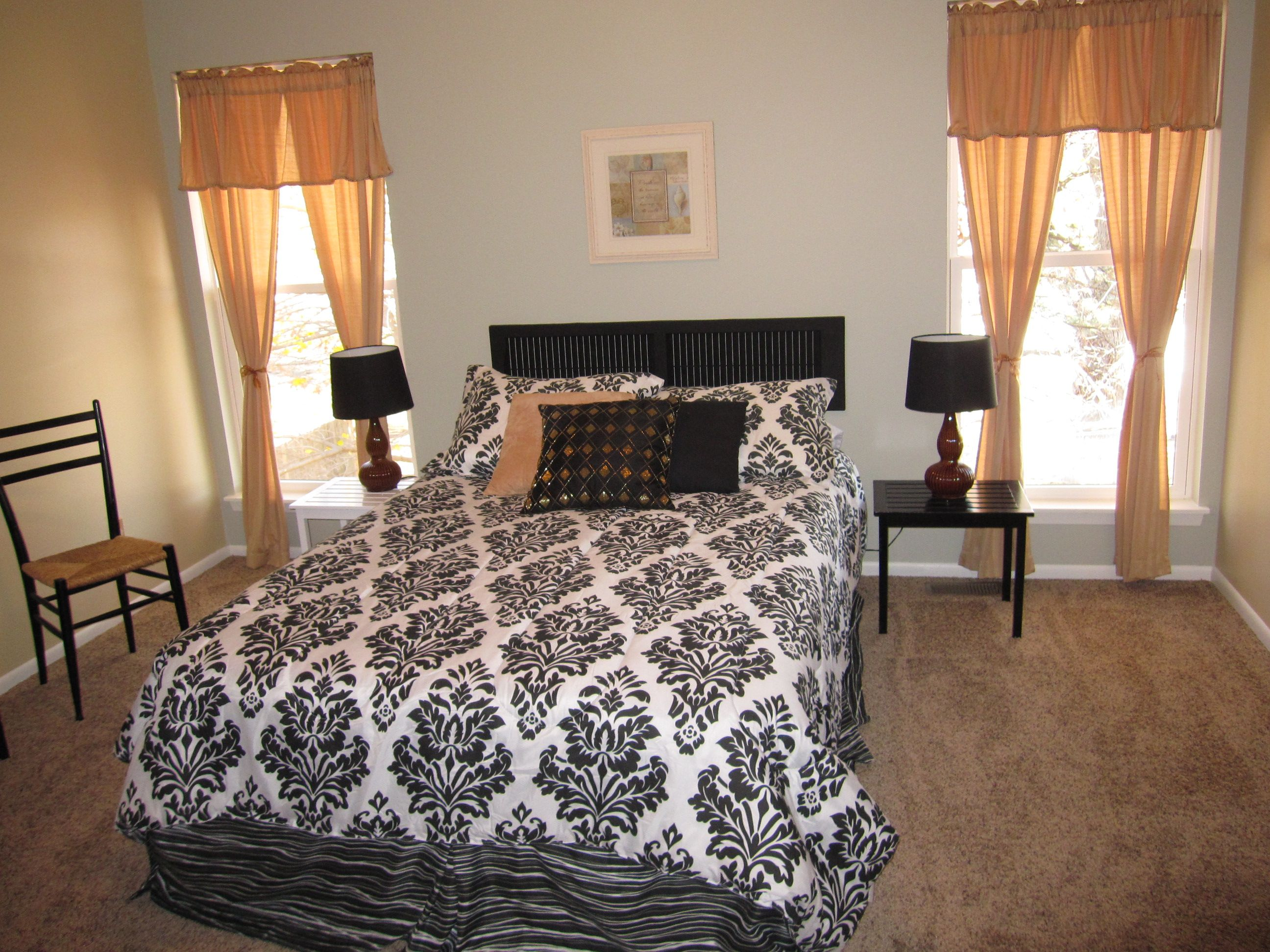 staged master bedroom that s an air mattress and a shutter for a