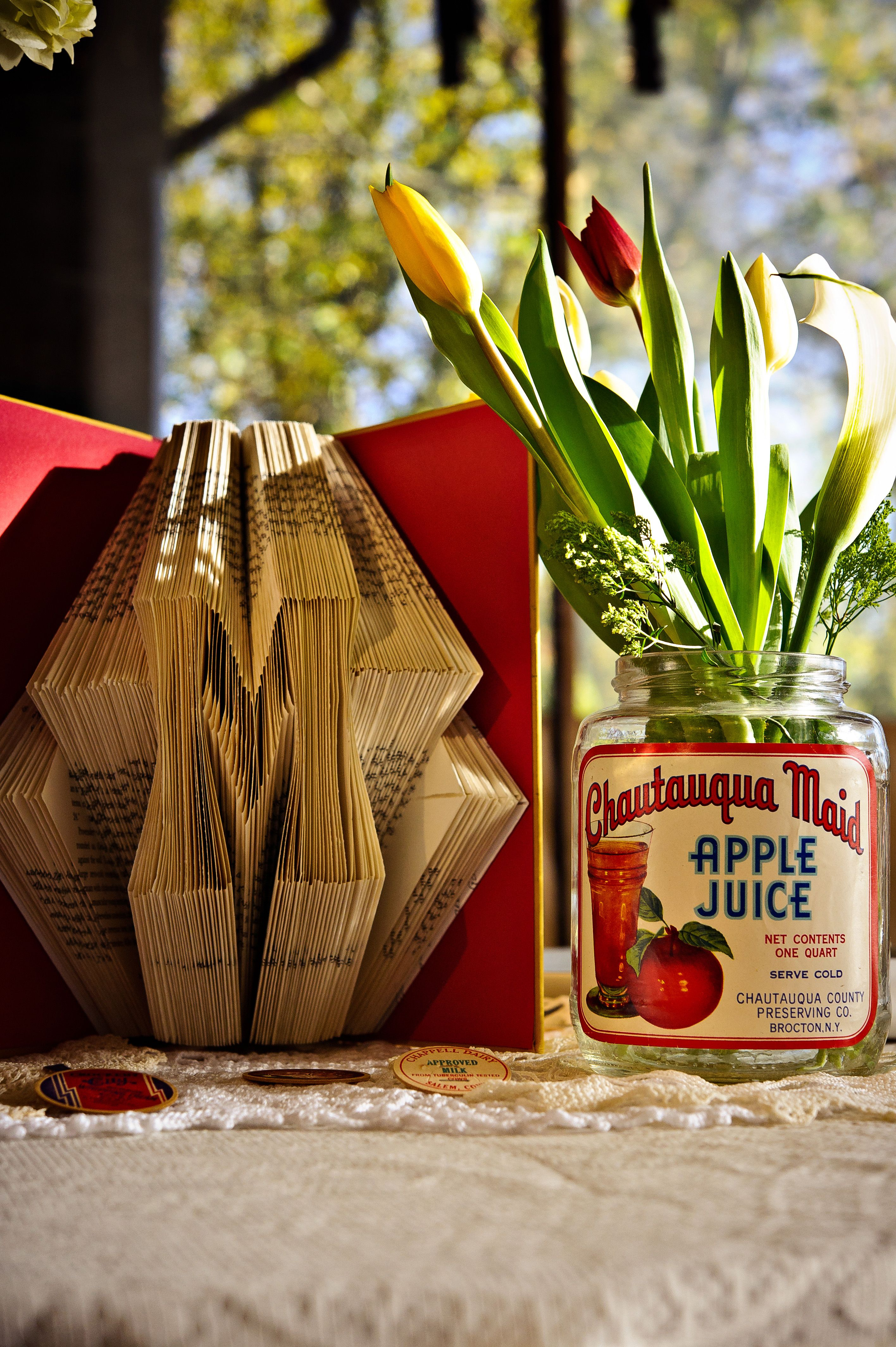 wedding decorations - folded books and jars with vintage labels