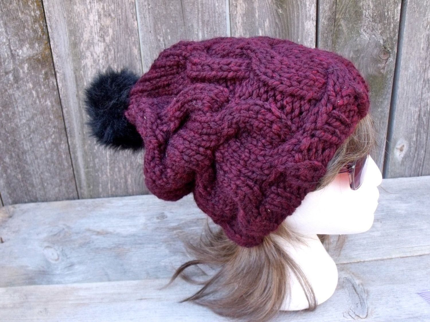 A personal favorite from my Etsy shop https://www.etsy.com/listing/210382958/womens-cable-knit-hat-with-black-fur-pom