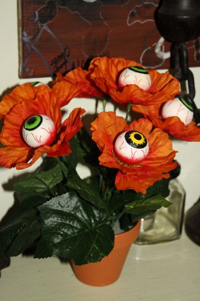 paint ping pong balls to look like eyeballs and glue into flowers for table decor - Halloween Ping Pong Balls