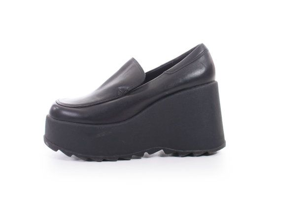 96aff3b9cfc5 1990s vintage black leather super chunky platform slip on shoes. Black  heavy rubber platform sole. Rugged tread on bottom of sole. Leather interior