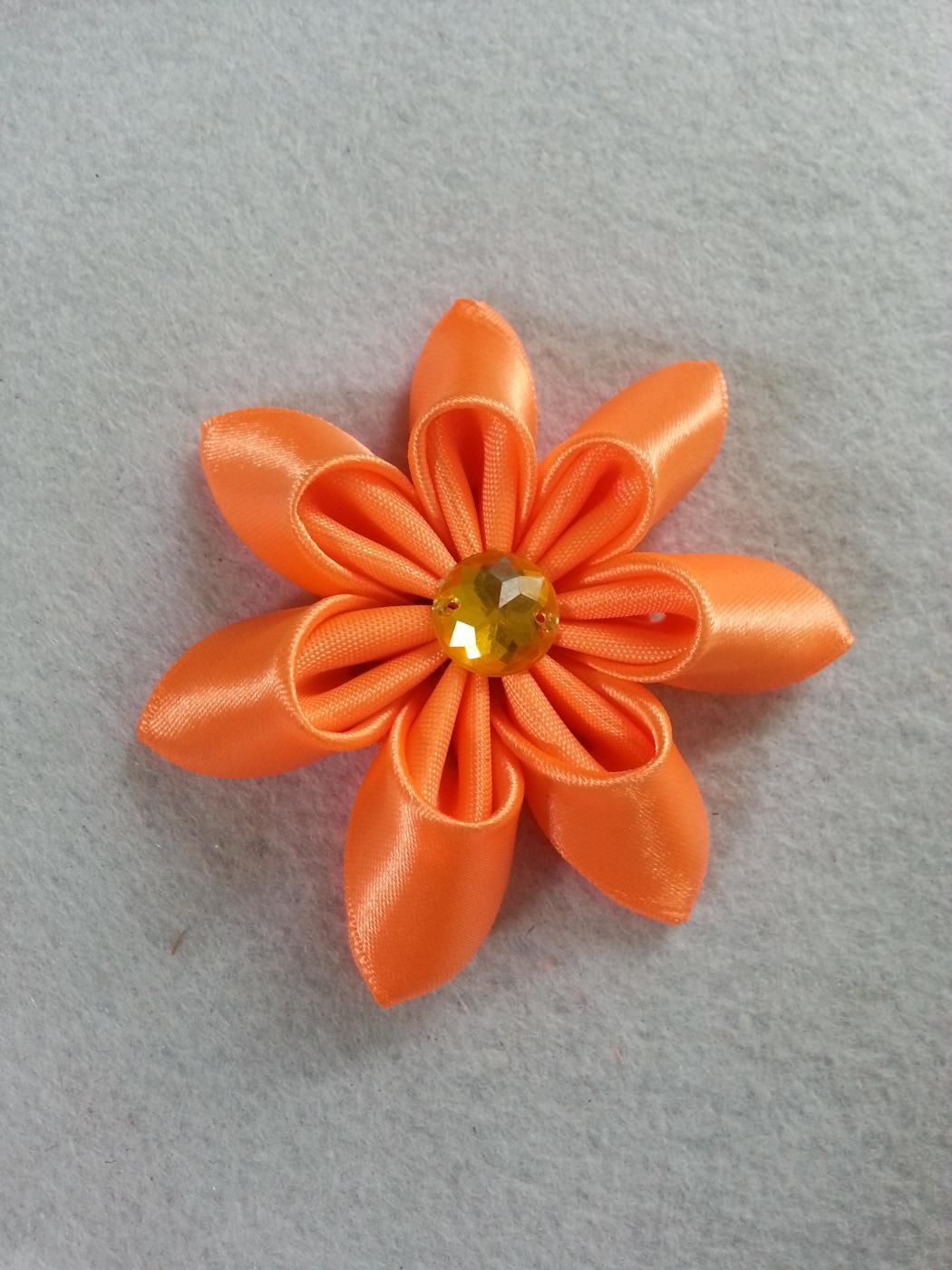 Diy ribbon flower ribbon pinterest fabric glue flower and make beautiful flowers for your craft projects this flower will make a lovely wedding bouquet brighten up your scrapbook make beautiful hair accessories izmirmasajfo