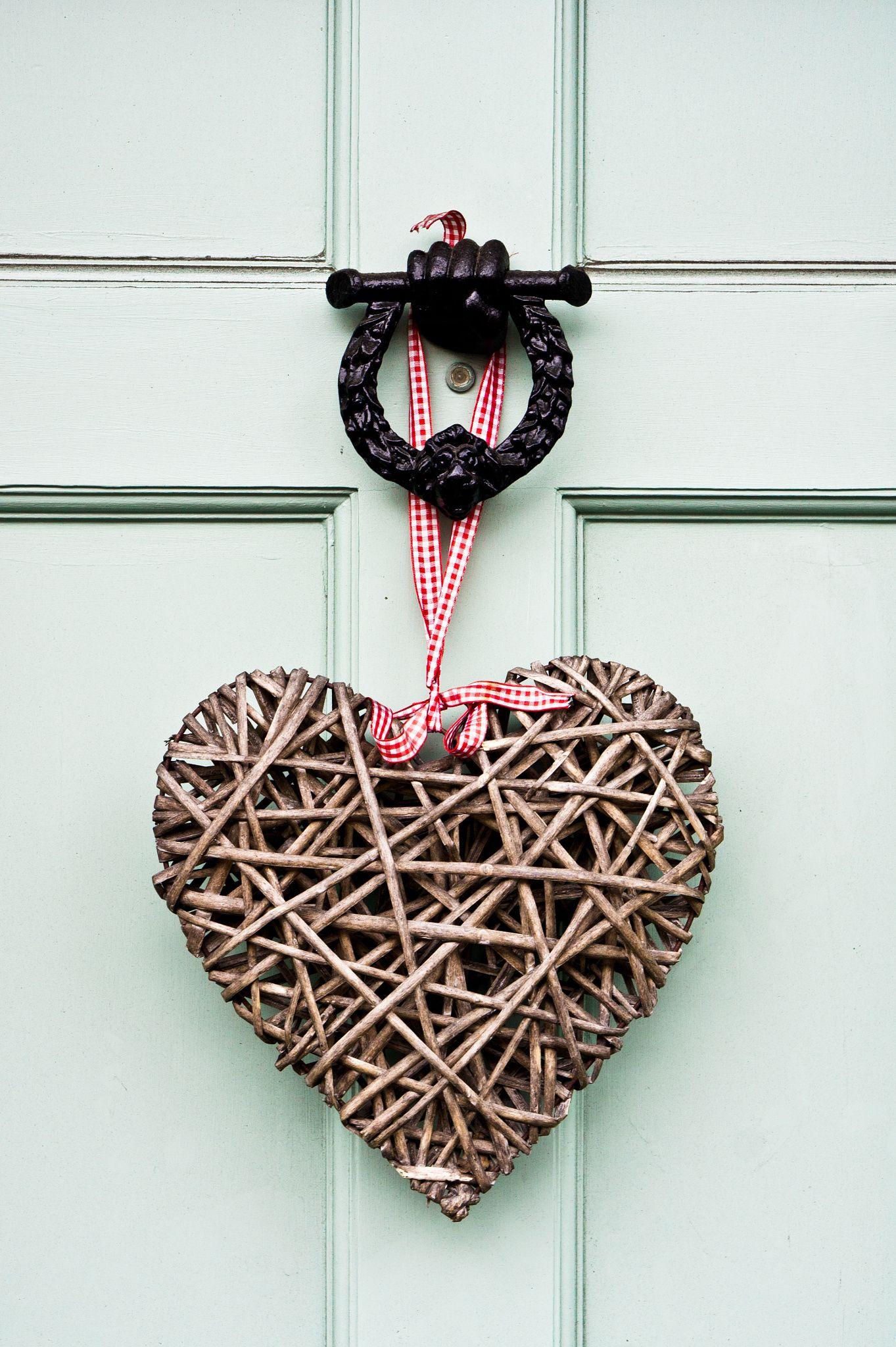 Wreath a heart shaped wreath on a front door love is in wreath a heart shaped wreath on a front door rubansaba