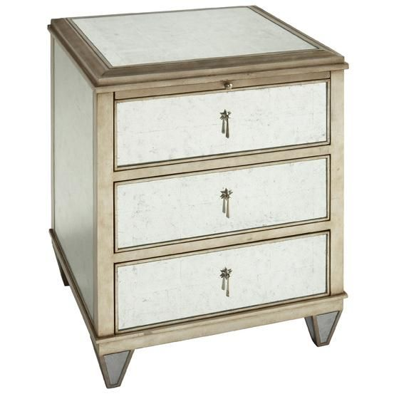 Three drawers with Eglomise front panels. One pull-out tray above top drawer. Estate Silver Finish and Eglomise.