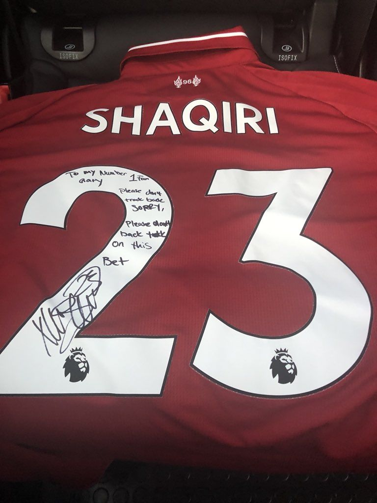 a7802f94752 Xherdan Shaqiri gives Jamie Carragher a signed shirt with a special message  for Gary Neville written on the back