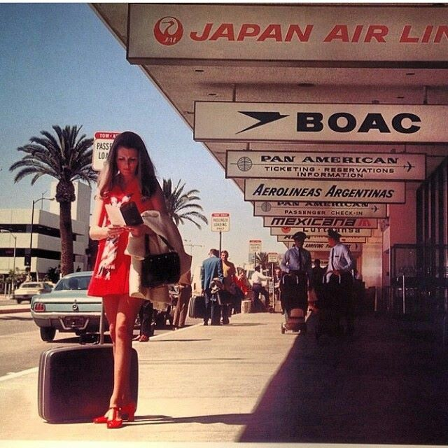 Vintage Airport scene with signs of airlines serving airport