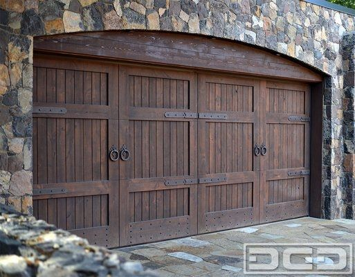 855 343 3667 Custom Tuscan Style Garage Door In Solid Alder Wood With Hand Forged Decorativ Garage Door Design Wooden Garage Doors Custom Wood Garage Doors