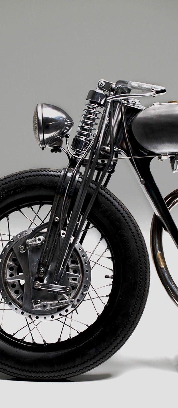 Old school design, - Girder front forks and drum brake can